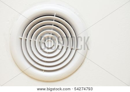 Circular Plastic Air Vent In White Wall