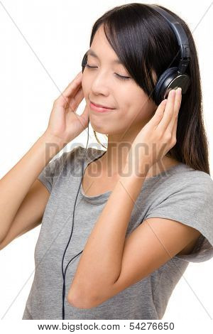 Asian woman enjoy music with earphone
