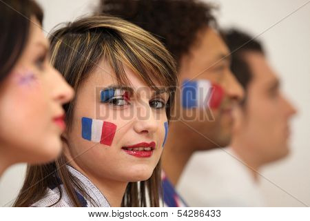 Friends watching the French team play a soccer game