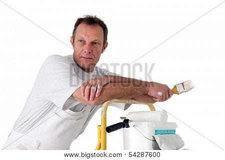 Painter resting on a stepladder