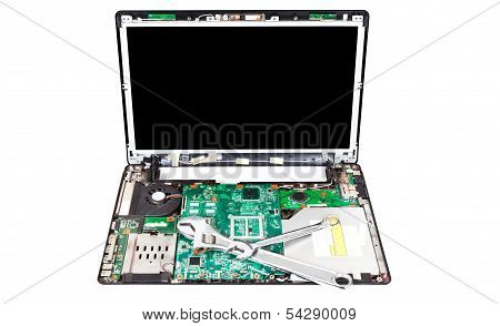 Laptop Disassembled With Two Wrenches On It