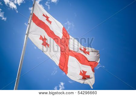 Georgia flag under the sky