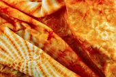 orange decorative fabric with an abstract pattern poster