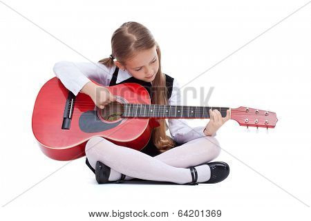 Little girl with red guitar sitting on the floor - isolated