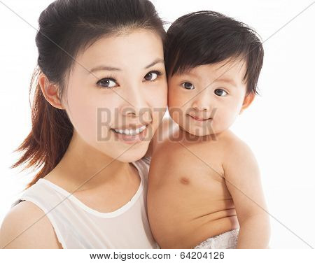 Happy  Mother Holding Smiling Child Baby