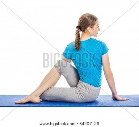 Yoga - young beautiful slender woman yoga instructor doing Half Lord of the Fishes Pose (Half Spinal Twist Pose) (Ardha Matsyendrasana) asana exercise isolated on white background