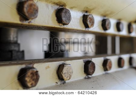 Nut and bolts on the machine , bolt is equipment of the machine or the equipment