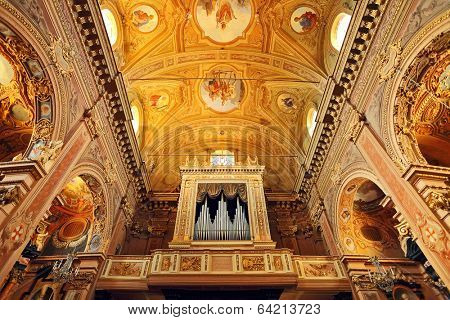 LA MORRA, ITALY - MAY 26, 2013: Organ in the church of St. Martin in town of La Morra. Pipe organ - essential part of catholic church was firstly introduced by Pope Vitalian in the 7th century.