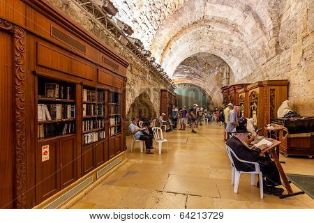JERUSALEM, ISRAEL - AUGUST 21, 2013: Prayers and visitors inside of Cave Synagogue which is a part of Western Wall (aka Wailing Wall) - Judaism's holy place located in Jerusalem, Israel.