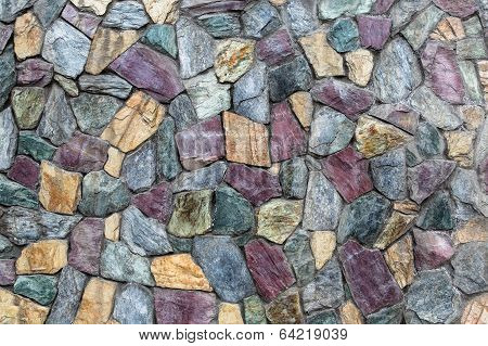 Abstract Texture Of The Stone Masonry Colored Stone. Stone Wall.