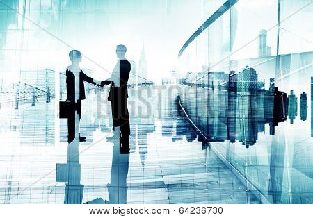 Silhouettes of Two Businessmen Having a Handshake