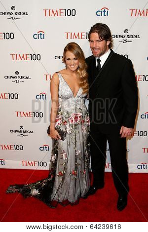 NEW YORK-APR 29: Singer Carrie Underwood and Mike Fisher attend the Time 100 Gala for the Most Influential People at Frederick P. Rose Hall at Lincoln Center on April 29, 2014 in New York City.
