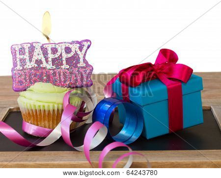 cupcake with candle happy birthday and gift box
