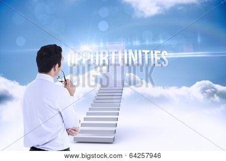 The word opportunities and businessman holding glasses against shut door at top of stairs in the sky