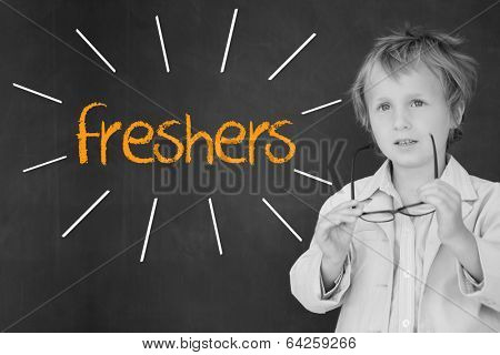 The word freshers against schoolboy and blackboard