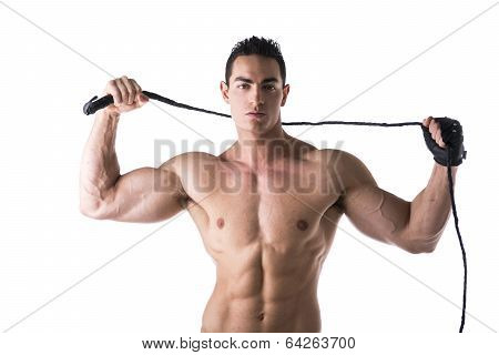 Muscular Shirtless Young Man With Whip And Studded Glove