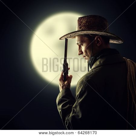 Cowboy Holding Hat And Revolver