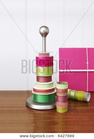 Rolls Of Ribbon Stacked Onto A Paper Towel Holder