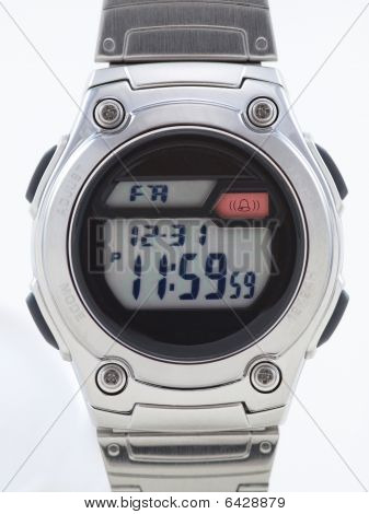 Digital Watch Face Close Up With Red Alarm