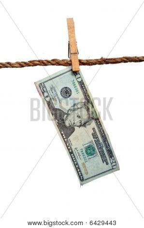 A Dripping 20 Dollar Bill On A Clothesline: Money Laundering Concept