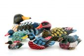 Many wooden colorful water ducks with white background poster