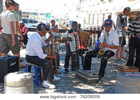 African Street Musicians On The Waterfront In Capetown, South Africa.