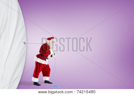 Santa claus pulling rope against purple vignette poster