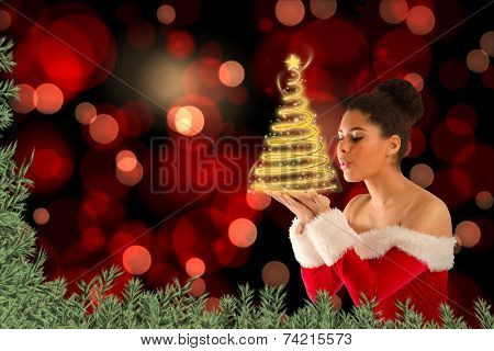 Pretty santa girl blowing over her hands against green fir branches poster