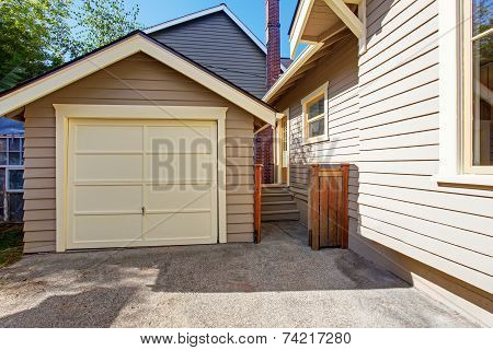 House And Garage In Clapboard Siding Trim