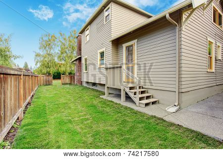 House With Small Deck And Backyard