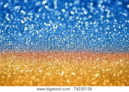 A blue and gold glitter sparkle background poster