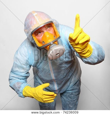 Man in protective clothing with respirator. Infection control concept.