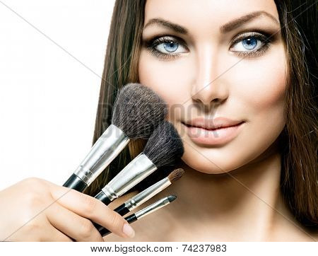 Beauty Girl with Makeup Brushes. Natural Make-up for Brunette Woman with Brown Eyes. Beautiful Face. Makeover. Perfect Skin. Applying Makeup  poster