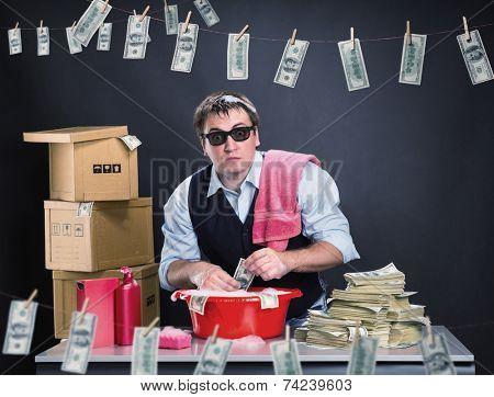 Scared businessman is laundering dollars