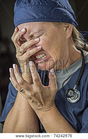 Hysterical Agonizing Crying Female Doctor or Nurse.