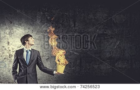 Young businessman hand holding yellow bucket in hand poster