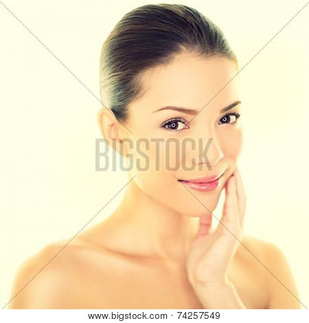 Woman beauty skincare woman touching perfect skin on face. Beautiful wellness beauty care and spa concept with multi-ethnic Chinese Asian / Caucasian girl with healthy glowing skin.