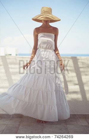 Beautiful young lady in straw hat in the sunlight poster