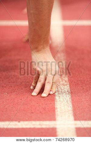 LINZ, AUSTRIA - JANUARY 30, 2014: Przemyslaw Slowikowski (#221 Poland) places 3rd in the men's 60m event in an indoor track and field meeting.