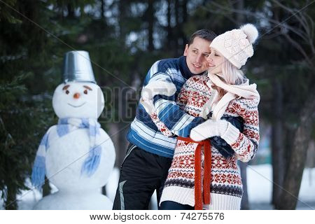 Have Fun And Laughs Next To The Snowman