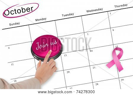 Hand pushing pink button for breast cancer awareness on october calendar poster