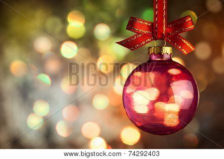 Christmas  bauble over Beautiful magic bokeh background -  horizontal