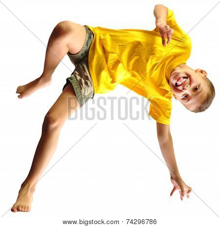 Cute Boy Exercising, Dancing And Jumping Over White