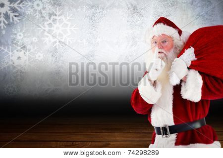 Santa claus carrying sack against shimmering light design over boards poster