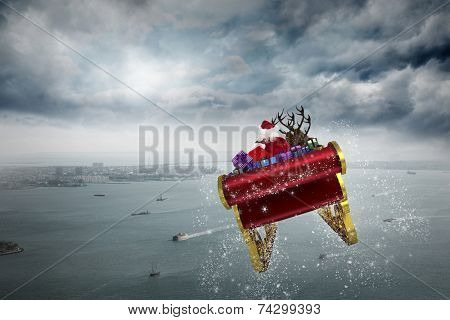 Santa flying his sleigh against coastline and city poster