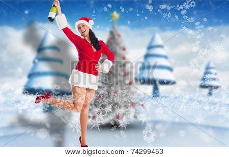 Woman smiling with champagne bottle against blurry christmas scene poster