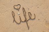 close up of word 'life' written in sand at beach poster