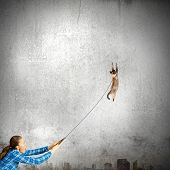 Young girl in casual with cat on lead poster