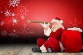 Santa claus looking through telescope against snowflake wallpaper over floor boards poster