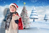 Smiling woman wearing santa hat against blurry christmas scene poster